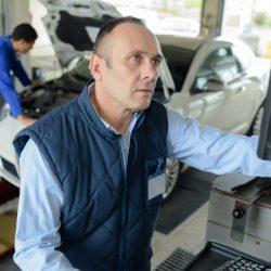 mechanic checking emissions