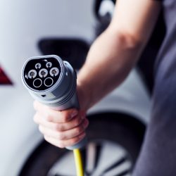 hand-holding-power-cable-for-electric car